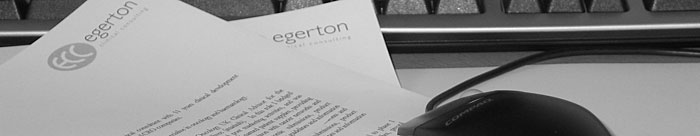 Montage of Egerton Clinical Consulting stationery and desk